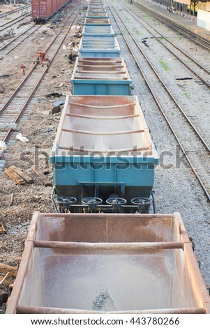 perspective of metal cargo train container on railway at the station. - stock photo