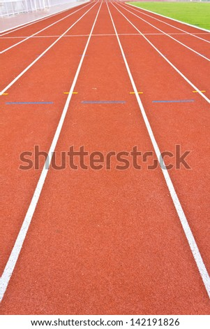 perspective of running track lines - stock photo