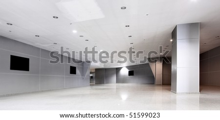 Perspective of the corridor at modern office building - stock photo