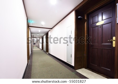 Perspective of the long corridor in hotel - stock photo