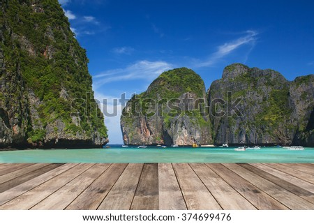 Perspective of wood terrace against beautiful seascape with free copy space use for background or backdrop.Blue lagoon at Phi Phi island,Maya bay,Krabi Province,Thailand - stock photo