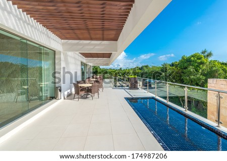 Perspective, outlook at the modern stylish restaurant, cafe, bar on the balcony, deck, patio of the luxury Mexican resort. Exterior, interior design. - stock photo