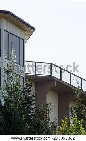 Perspective, silhouette of the modern glass and steel balcony, deck railing.