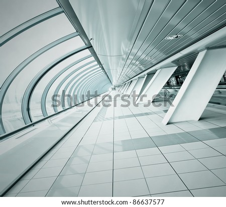 perspective tilt view to spacious corridor in contemporary airport walkway - stock photo