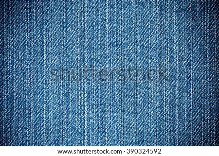 Perspective View of Blue Denim Fabric Texture close up View with vertical Direction of Threads for traditional Business Background in cold tones - stock photo
