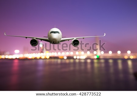 perspective view of jet airliner in flight with bokeh background