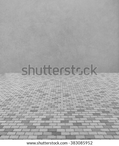 Perspective View of Monotone Gray Brick Stone Street Road. Sidewalk, Pavement Texture Background with Abstract Gray Wall for Interior Design - stock photo