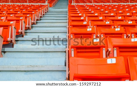perspective view of orange seats in rows - stock photo