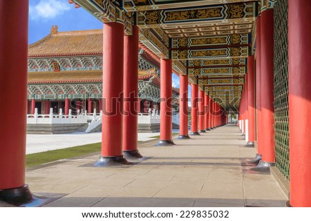 Perspective View of The Corridor of A Confucius Temple With The Main Temple Seen Between The Pillars.  A Typical Chinese Palace Architecture. A Tourist Site in Kaohsiung, Taiwan.  - stock photo
