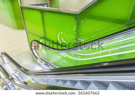 Perspective wide angle of escalators, green color combination.  - stock photo