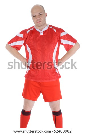 Perspiring young footballer. Isolated on white background - stock photo