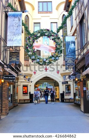 PERTH, AUSTRALIA - November 14. People in motion are shopping in the holiday season in the historic street  London Court on November 14, 2015 in Perth.   - stock photo