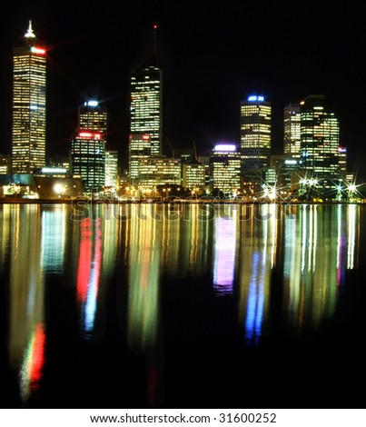 Perth City at night with reflections mirrored in the Swan River - stock photo