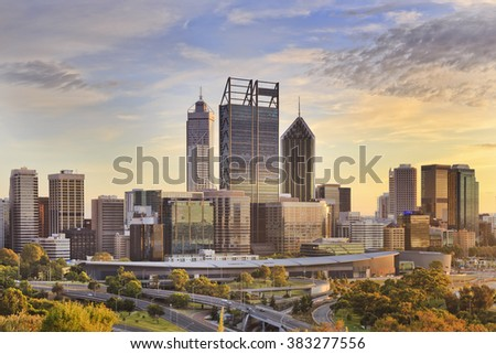 Perth city CBD towers close up view from lookout of Kings park at sunrise during gold sun light hour.