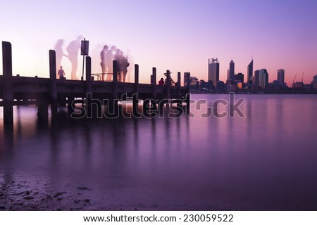 Perth city skyline and pier at night - stock photo