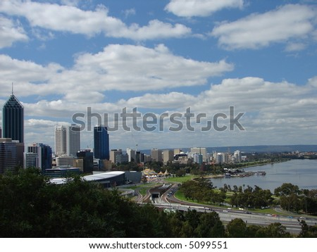 Perth skyline, next to swan river against cloudy blue sky - stock photo