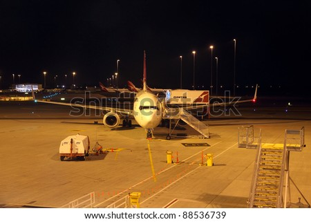 PERTH,WA/AUSTRALIA - OCTOBER 15: A Qantas Airbus A330 airplane sits on the tarmac and prepares for boarding amidst the Qantas strikes on October 15, 2011 at Perth International Airport in Perth, WA, Australia. - stock photo