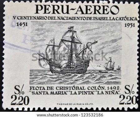 PERU - CIRCA 1951: Stamp printed in Peru dedicated to Birth of Isabella the Catholic shows fleet of Christopher Columbus, circa 1951 - stock photo