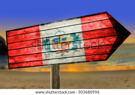 Peru Flag on wooden table sign on beach background - stock photo