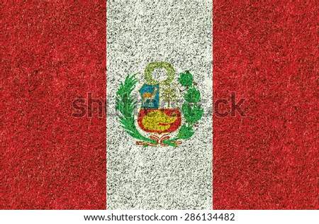 Peru flag texture on green grass in the garden for background - stock photo