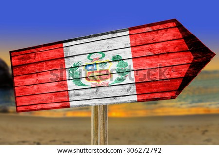 Peru flag wooden sign with on a beach background - stock photo