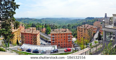 PERUGIA, ITALY- APRIL 22: Panoramic view of a town on April 22, 2011 in Perugia, Italy. Perugia hosts Jazz, Chocolate and Journalism festivals attracting many tourists each year. - stock photo