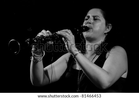 PERUGIA, ITALY - JULY 15 : Anat Cohen plays clarinet on main stage at Umbria Jazz Festival - July 15, 2011 in Perugia, Italy