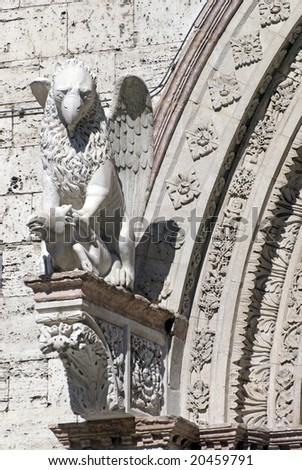 Perugia (Umbria, Italy) - Statue of gryphon (griffin, griffon) on a historic building