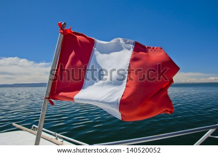 Peruvian flag waving in wind - stock photo