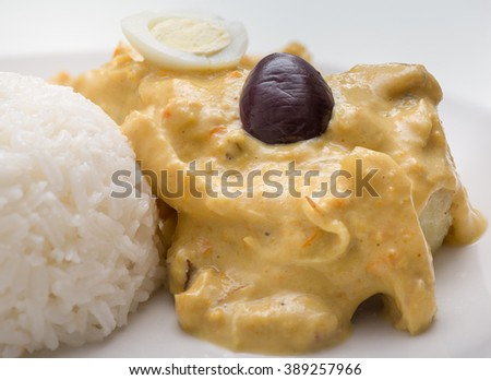 Peruvian food: Aji de Gallina, treditional recipe with chicken meat and pepper sauce. - stock photo