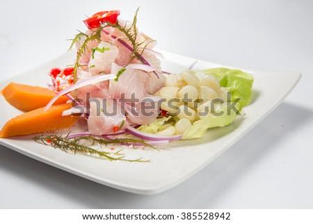 Peruvian food: Cebiche de pescado. - stock photo