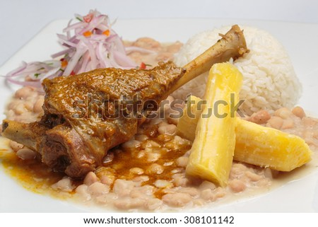"Peruvian food, ""Seco de cabrito"" a goat meal served with rice and beans. - stock photo"