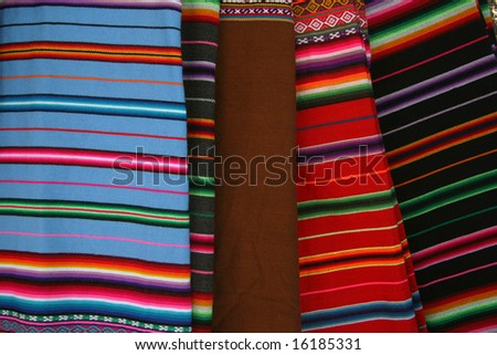 Peruvian hand made woolen fabrics at the local market. - stock photo