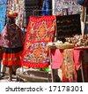 Peruvian Indian woman looking at colorful textiles,Ollantaytambo, Peru, South America - stock photo