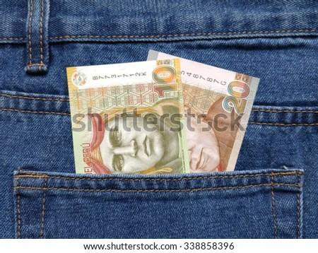 Peruvian money in pocket - stock photo