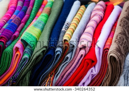 Peruvian scarves shawls on the market - stock photo