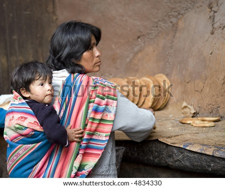 Peruvian Woman at Bakery in Pisac Peru - stock photo