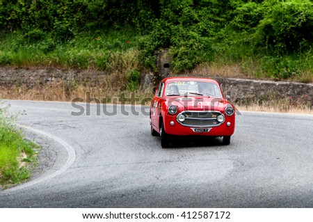 Pesaro, Italy - May 15, 2015: FIAT 1100 103 TV Coupé Vignale 1954 in nidentified crew on an old racing car in rally Mille Miglia 2015 the famous italian historical race (1927-1957)