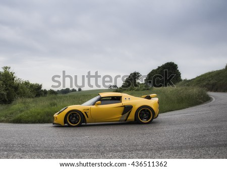 PESARO, ITALY - MAY 15: lotus elise yellow   on an old racing car in rally Mille Miglia 2015 the famous italian historical race (1927-1957) on May 2015