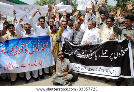PESHAWAR, PAKISTAN - AUG 23: Supporters of Khyber Union of Journalists (KUJ) are protesting in favor of their demands during demonstration on Tuesday, August 23, 2011in Peshawar. - stock photo
