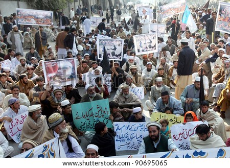 PESHAWAR, PAKISTAN - DEC 12: Members of Bara Affectees Movement are protesting in favor of their demands during demonstration in Peshawar on December 12, 2011. - stock photo