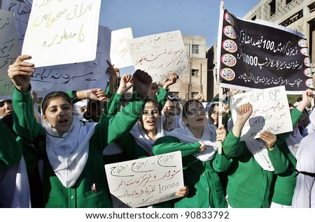 PESHAWAR, PAKISTAN - DEC 14: Nurses shout slogans in favor of their demands during protest demonstration at Hayatabad medical complex (HMC) in Peshawar, Pakistan on December 14, 2011. - stock photo