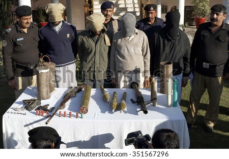 PESHAWAR, PAKISTAN - DEC 15: Police exposing terrorists associated with defunct Lashkar-e-Jhangvi arrested during raid in Mathra area at CPO Peshawar on December 15, 2015 in Peshawar.