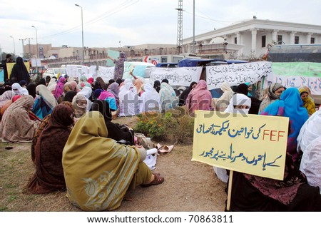 PESHAWAR, PAKISTAN - FEB 09: Veiled women members of Frontier Education Foundation (FEF) are protesting in favor of their demands during demonstration  on February 09, 2011in Peshawar. - stock photo