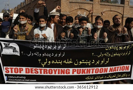 PESHAWAR, PAKISTAN - JAN 21: Members of Civil Society are protesting against attack on Bacha Khan University of Charsadda on January 21, 2016 in Peshawar.  - stock photo