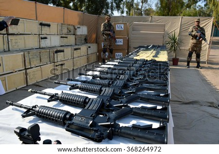 PESHAWAR, PAKISTAN - JAN 27: Security show recovered  large cache of foreign-made-weapons to media persons that were recovered in a search operation at various godowns on January 27, 2016 in Peshawar.