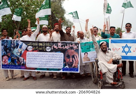 PESHAWAR, PAKISTAN - JUL 24: Awami Jamhoori are protesting against killing of Muslims in the Gaza Strip by Israel. 653 Palestinians have been killed and over 2500 injured on July 24, 2014 in Peshawar.