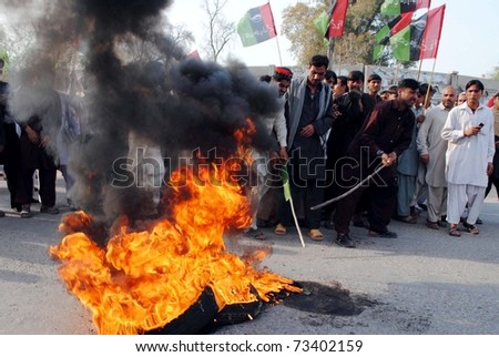 PESHAWAR, PAKISTAN - MAR 17: Activists of Peoples Party-Sherpao burn tires as they are protesting against release of Raymond Davis on March 17, 2011 in Peshawar.