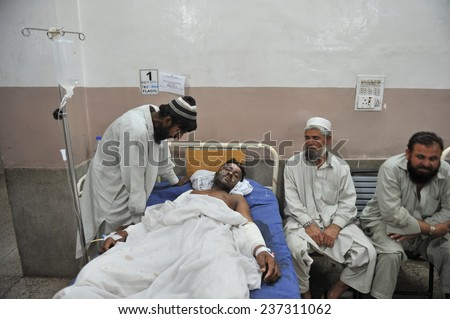 PESHAWAR, PAKISTAN - MAY 14: Victim of suicide bomb blast at police school area being admitted for treatment at Lady Reading hospital, on May  14, 2011 in Peshawar. - stock photo