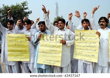 PESHAWAR, PAKISTAN - OCT 20: Activists of International Human Rights (PIHR) chant slogans in favor of their demands during protest demonstration on October 20, 2010 in Peshawar. - stock photo